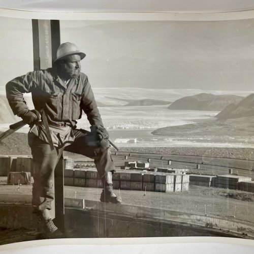 Steel worker looking out at the tundra landscape