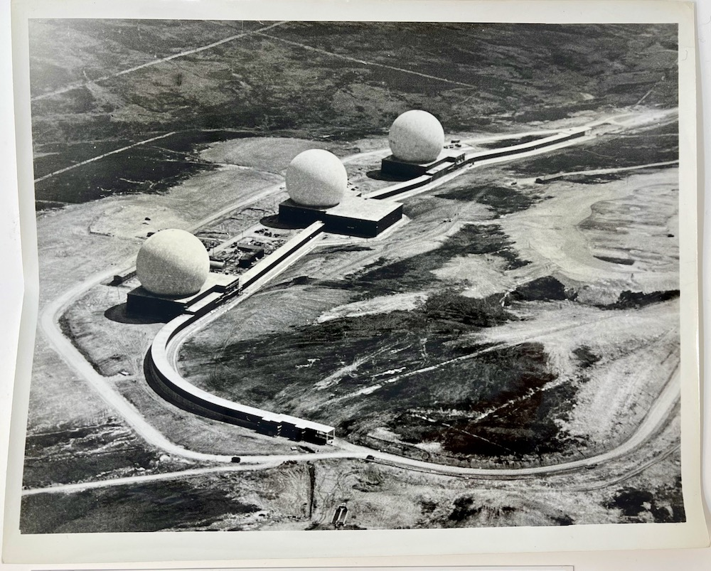Dennis Wompra Studios Collection, aerial view of three radomes, access tunnel and access roads